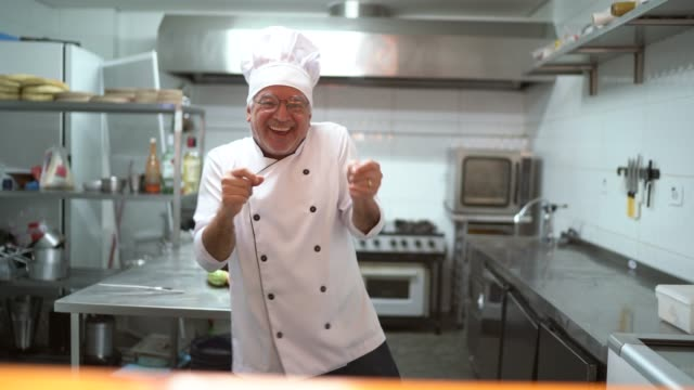 Senior chef dancing at kitchen