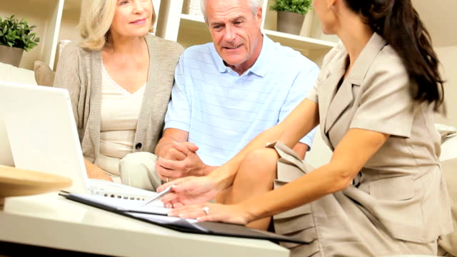 Senior Clients Meeting with Financial Advisor at Home