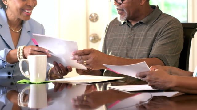 Senior couple at home with financial advisor