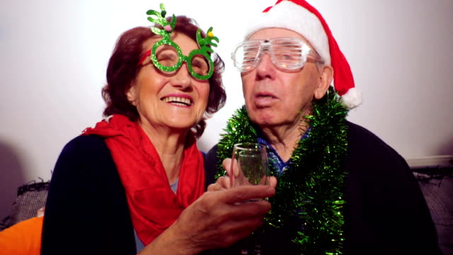 Senior couple celebrating New Year's Eve at home video
