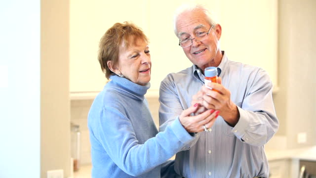 Senior couple discussing prescription medicine video