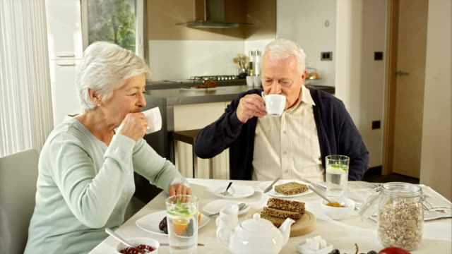 senior couple drinking tea at breakfast - tea cup stock videos & royalty-free footage