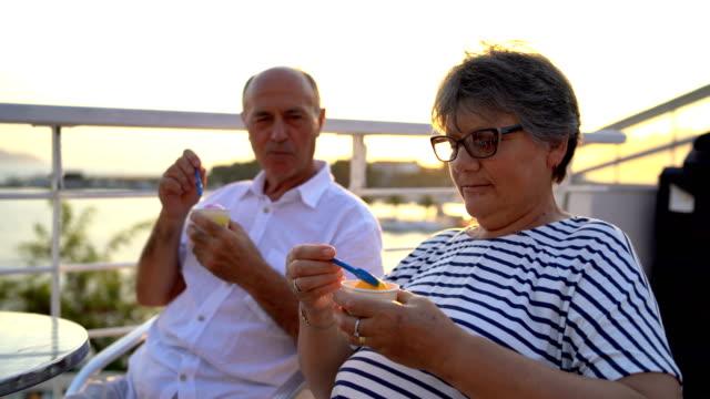 senior couple eating ice cream - dolci video stock e b–roll