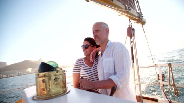 Senior couple enjoying a yacht cruise together video