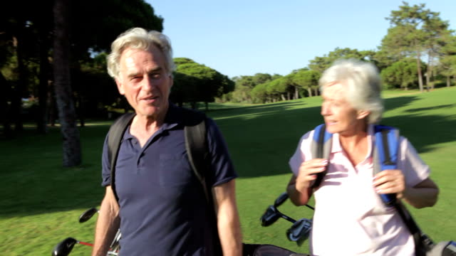 Senior Couple Enjoying Game Of Golf video