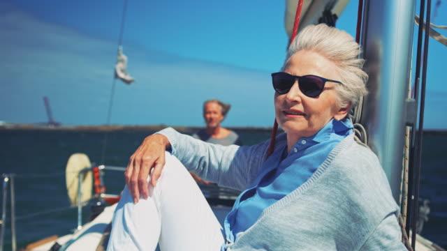 Senior couple enjoying in yacht during vacation
