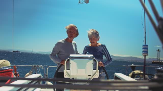 Senior couple enjoying marine vacation in yacht