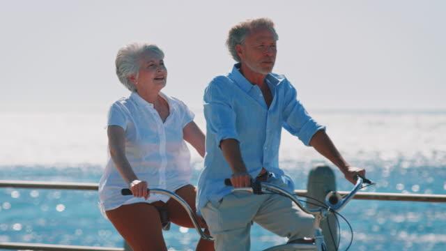 Senior couple exploring on tandem bicycle