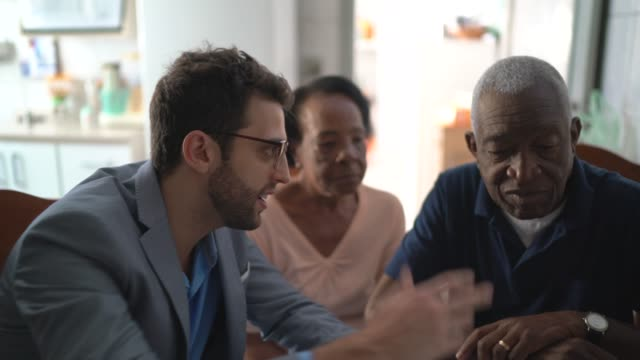 Senior couple having a consultation with a financial advisor at home Senior couple having a consultation with a financial advisor at home financial planning stock videos & royalty-free footage