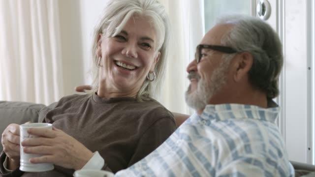 senior couple having fun while having coffee at home - 60 69 anni video stock e b–roll