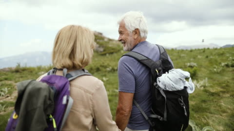 Senior couple hiking Video of an elderly couple during their hike with backpacks enjoyment stock videos & royalty-free footage
