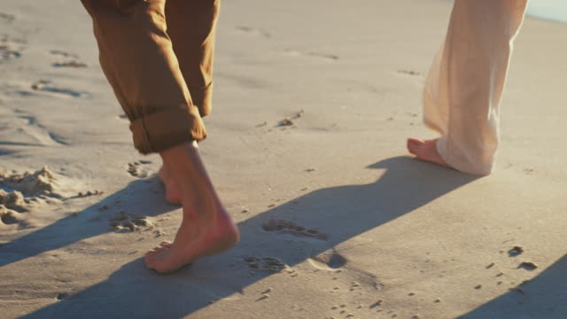 Senior couple holding hands on sea shore at beach