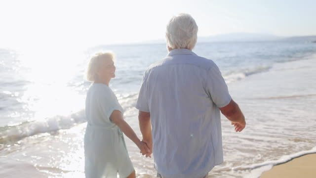 Senior couple in a walk by the sea