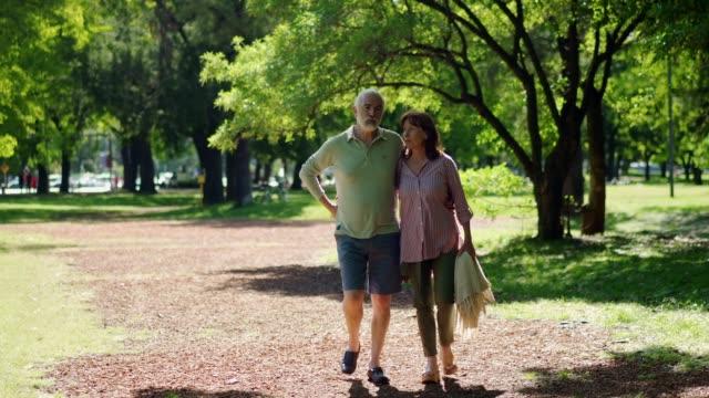 Senior couple in pleasant walk in a park