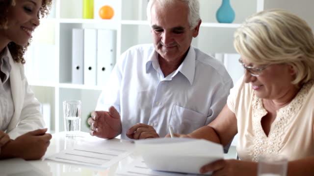 Senior Couple Meeting With Financial Advisor. video
