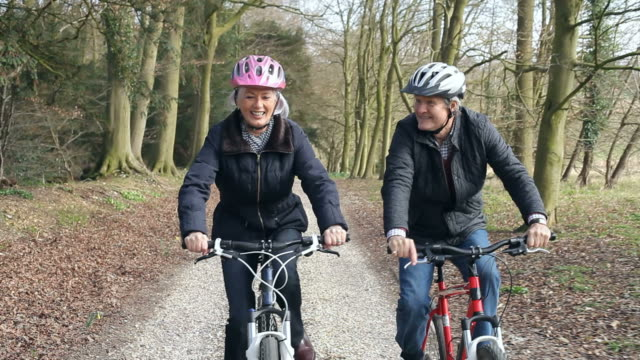 Senior Couple On Cycle Ride In Winter Countryside video