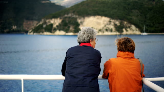 Senior couple on ferry Senior couple enjoying the view while riding on ferry. aging process stock videos & royalty-free footage
