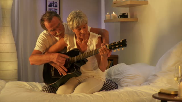 HD DOLLY: Senior Couple Playing The Guitar video