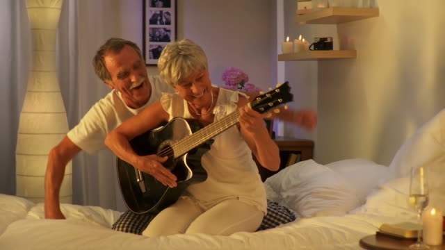 hd dolly: senior couple playing the guitar - baby boomers stock videos & royalty-free footage