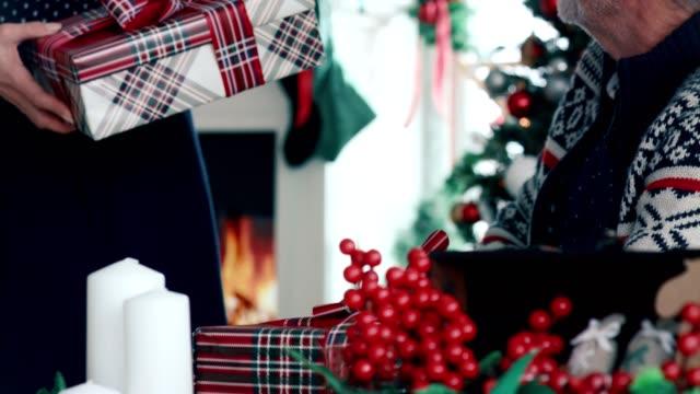 Senior couple preparing Christmas presents for holidays