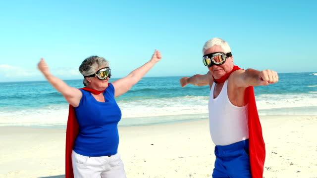 Senior couple pretending to be superhero video