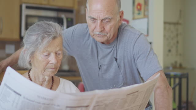Senior Couple Reads the Newspaper Together video