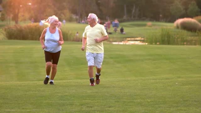 Senior couple running outdoors. video