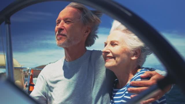 vídeos de stock e filmes b-roll de senior couple singing while enjoying in yacht - enjoying wealthy life