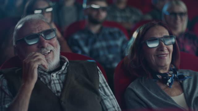 senior couple smiling at cinema - para aranżacja filmów i materiałów b-roll