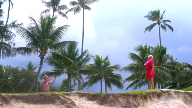 Senior Couple Taking a photo on Hawaii island in 4K slow motion 60fps