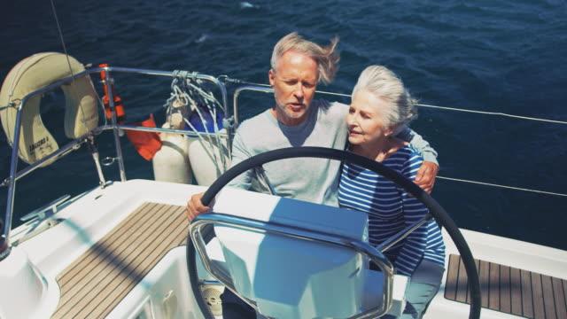 Senior couple talking while enjoying in yacht
