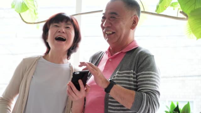Senior couple using smart phone video
