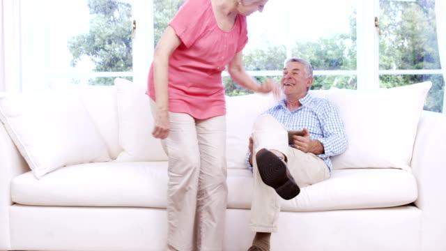 Senior couple using tablet video