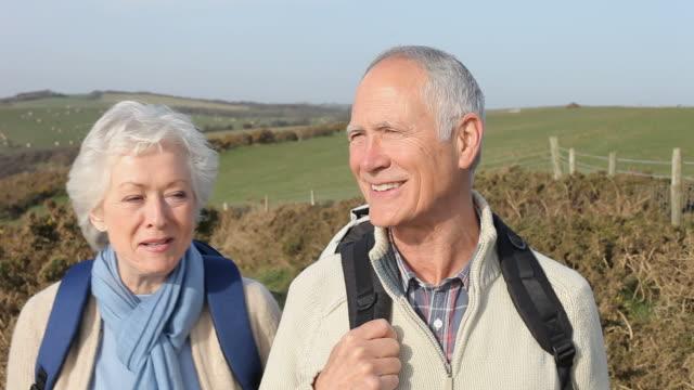 Senior Couple Walking Along Coastal Path video