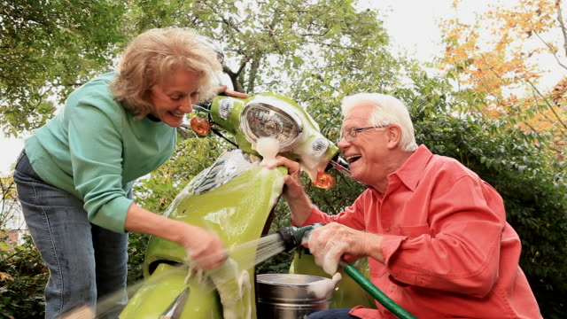 Senior Couple Washing Green Scooter video