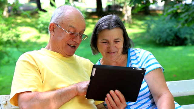 Senior couple with digital tablet pc video