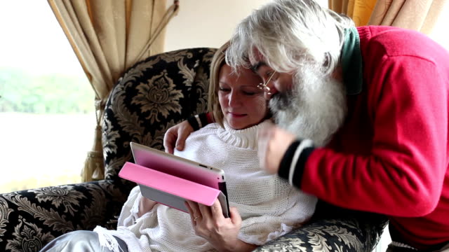 Senior couple with tablet video