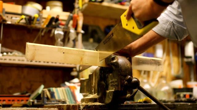 Senior Craftsman Sawing Wood video