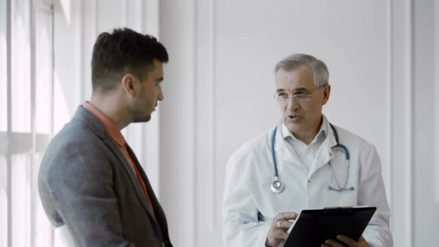Senior doctor consults patient video