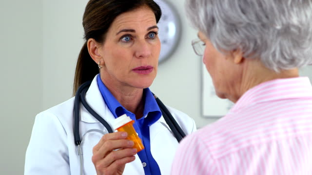Senior doctor talking to patient about medication video