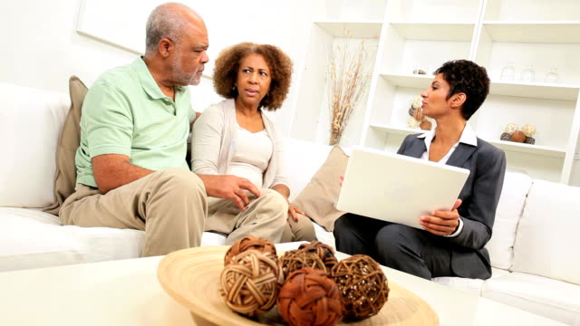 Senior Ethnic Couple Meeting Financial Advisor Home video