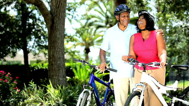 Senior ethnic successful couple start cycling video