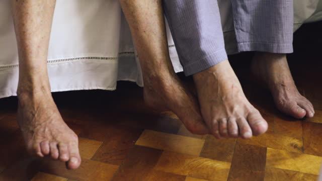 Senior feet close up waking up - video