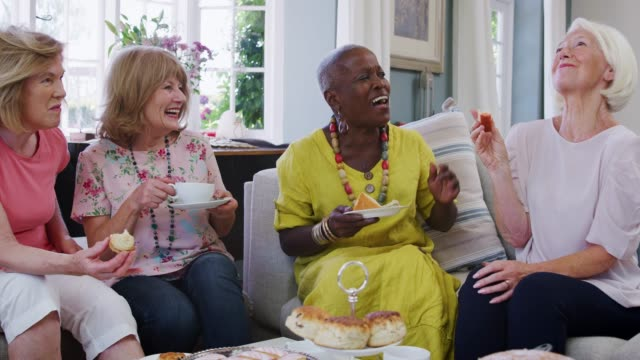 Senior Female Friends Enjoying Afternoon Tea At Home Together video