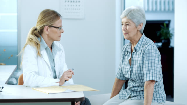 Senior female patient explaining symptoms to her female physician video