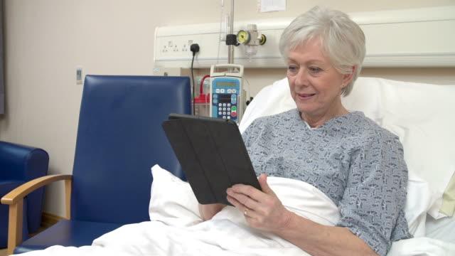 Senior Female Patient Using Digital Tablet In Hospital Bed video