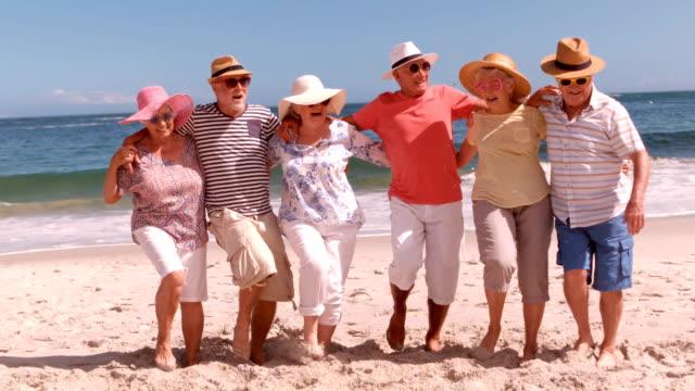 Senior friends dancing on the beach video
