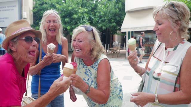 Senior Friends Enjoying Ice Cream A small group of senior women on holiday in Cyprus are enjoying ice cream cones. ice cream stock videos & royalty-free footage