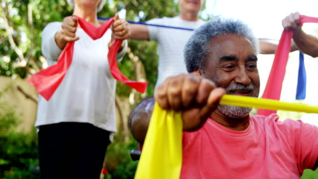 Senior friends exercising with resistance band 4k video