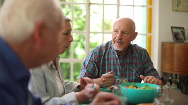 Senior friends having lunch